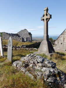 Cross and graves in Bardsey Churchyard